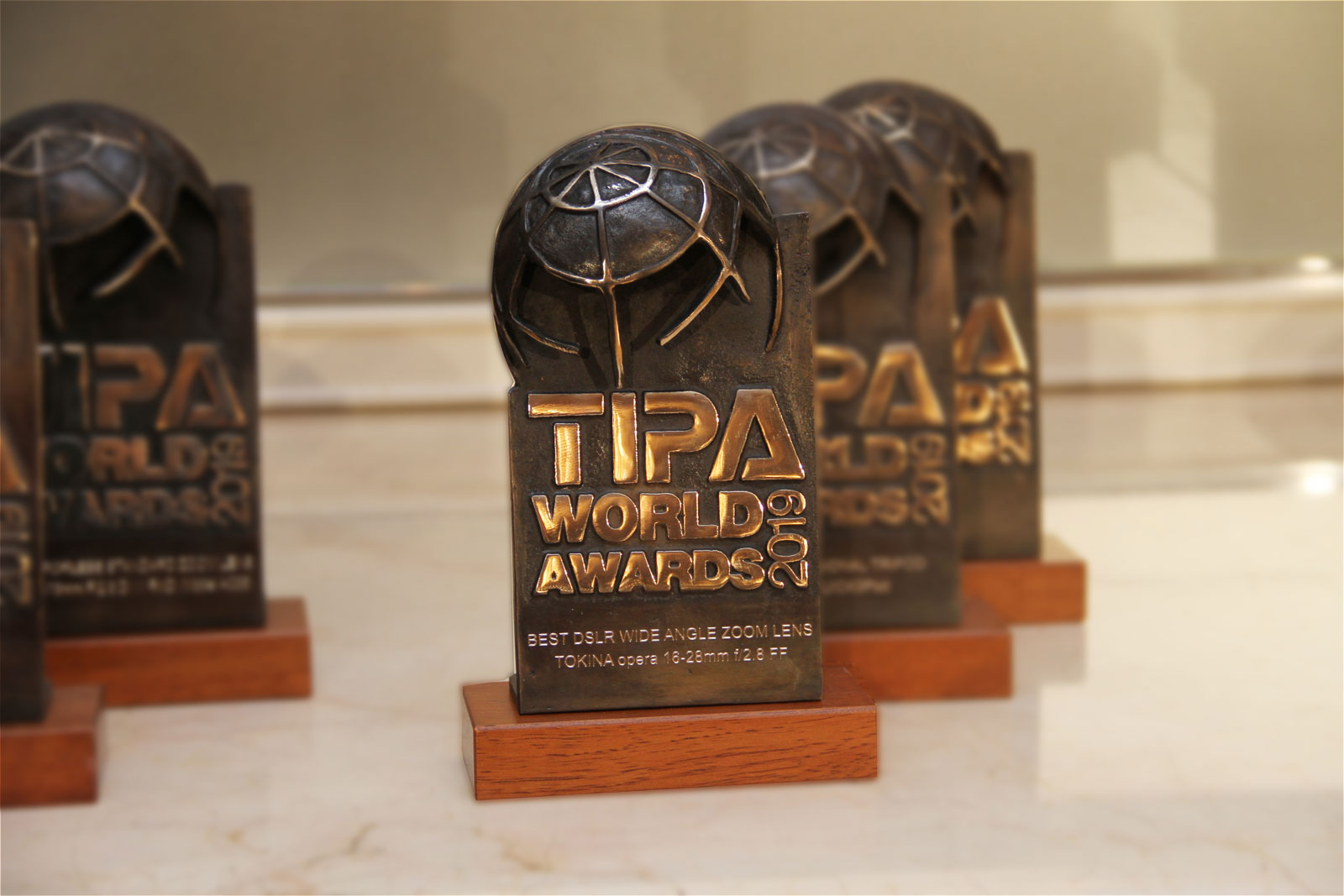 Tokina - Receiving TIPA World Award for opera 16-28mm F2 8 FF as the